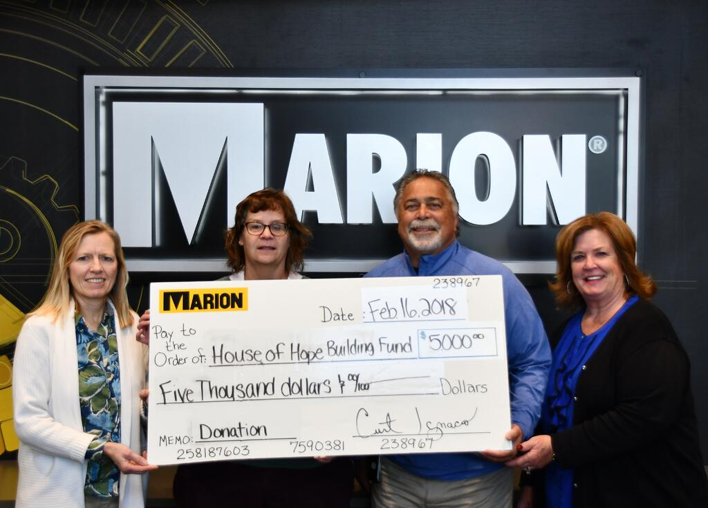 Marion donates to the House of Hope Building Fund